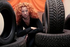 Woman and tires Royalty Free Stock Photos