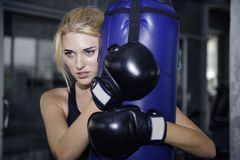 Woman tiring after  boxing. The woman tiring after boxing training Royalty Free Stock Photography