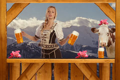 Woman in Tirol Oktoberfest look serving beer Stock Images