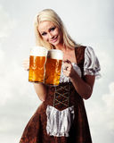 Woman in tiroler oktoberfest style with beer Stock Photography
