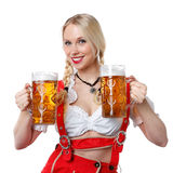 Woman in tiroler oktoberfest style with a glass of beer Royalty Free Stock Photos
