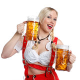 Woman in tiroler oktoberfest style with a glass of beer Stock Photography