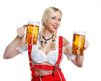 Woman in tiroler oktoberfest style with a glass of beer Royalty Free Stock Photo