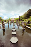Woman in Tirtagangga water palace on Bali island Royalty Free Stock Images