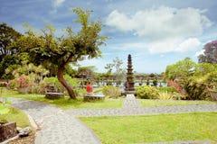 Woman in Tirtagangga water palace on Bali island Stock Photos