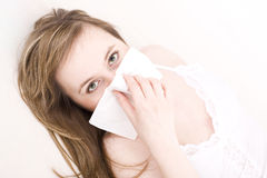 Woman with tissue. Pretty woman with tissue / allergy Stock Image
