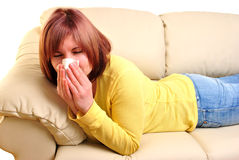 woman with a tissue on a couch Stock Images