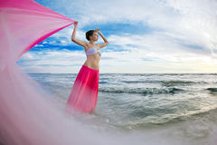 Woman with a tissue in his hands on the beach Stock Image