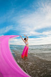 Woman with a tissue in his hands on the beach Royalty Free Stock Image