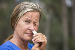 Woman tissue in nose suffering cold or hayfever Stock Photo