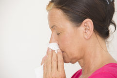 Woman with tissue on nose suffering cold Royalty Free Stock Photos