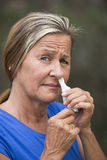 Woman tissue in nose suffering flu or hayfever Stock Image