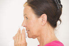 Woman with tissue at nose suffering flu Royalty Free Stock Photo