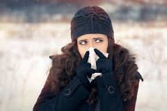 Woman with Tissue Outside Feeling Bad Cold Winter Stock Image