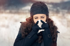 Woman with Tissue Outside Feeling Bad Cold Winter Royalty Free Stock Photography