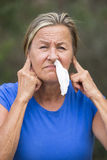 Woman with tissue in running nose outdoor Stock Images
