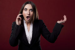 Woman to answer the phone Stock Photography