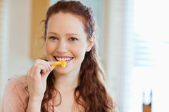 Woman about to bite into bell pepper Royalty Free Stock Photography
