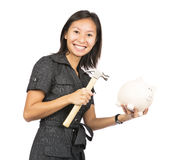 Woman about to break piggy bank. Female holding piggy bank isolated on white background Royalty Free Stock Photos