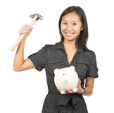 Woman about to break piggy bank. Female holding piggy bank isolated on white background Royalty Free Stock Image