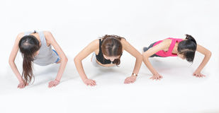 Woman to do push-ups Royalty Free Stock Photos