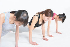 Woman to do push-ups Stock Photos