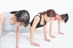 Woman to do push-ups Stock Photos