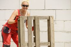 Woman working with pallets on construction site stock images