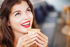 Woman about to drink coffee Royalty Free Stock Photos