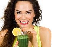 Woman about to drink a green smoothie. Beautiful healthy smiling woman holding and about to drink an organic green smoothie. Isolated on white stock photos
