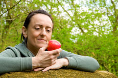 Woman about to eat an apple Royalty Free Stock Image