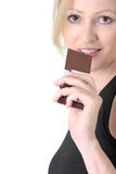 Woman about to eat a chocolate bar