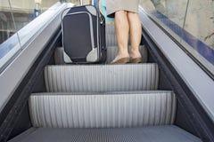 Woman to escalator Stock Photos