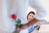 Woman about to get a rose from her boyfriend Royalty Free Stock Photography