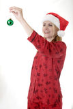 Woman about to hang a Christmas ornament Royalty Free Stock Photography