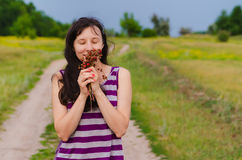 Woman to hold and smelling wild strawberries Stock Photography