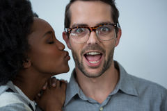 Woman about to kiss man Royalty Free Stock Photos