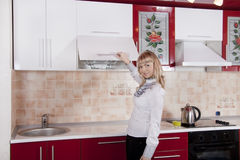 Woman to kitchen. Young woman to kitchen in red-white color Stock Photos