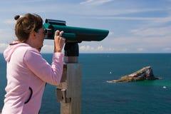 Woman to look through binoculars, island Stock Photos