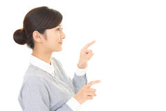 Woman to point at something Stock Photos