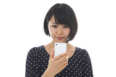 Woman to see a smartphone. Young woman to see a smartphone Stock Photo