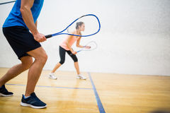 Woman about to serve the ball Royalty Free Stock Images