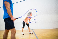 Woman about to serve the ball Stock Image