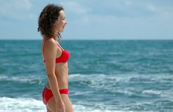 Woman to stand and smile. The woman to stand and looks at the sea Stock Images