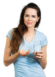 Woman about to take pills. Stock Photos