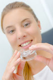 Woman about to use mouth guard whilst at dentist Stock Photo