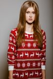 Woman to the waist with big eyes in a sweater Stock Images