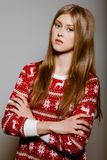 Woman to the waist with big eyes in a sweater Stock Photography