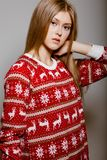 Woman to the waist with big eyes in a sweater Royalty Free Stock Images