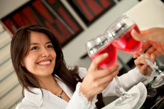 Woman toasting Stock Photography